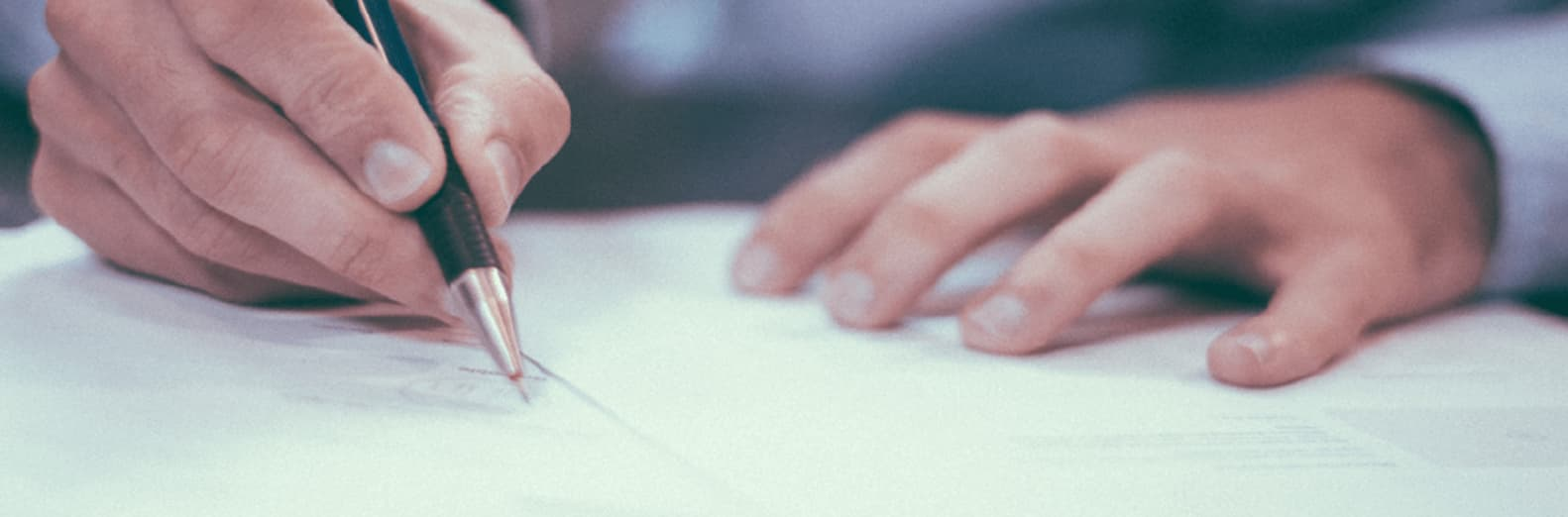 Man signing employment contract-min