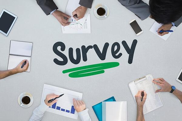 The word survey against business meeting-min