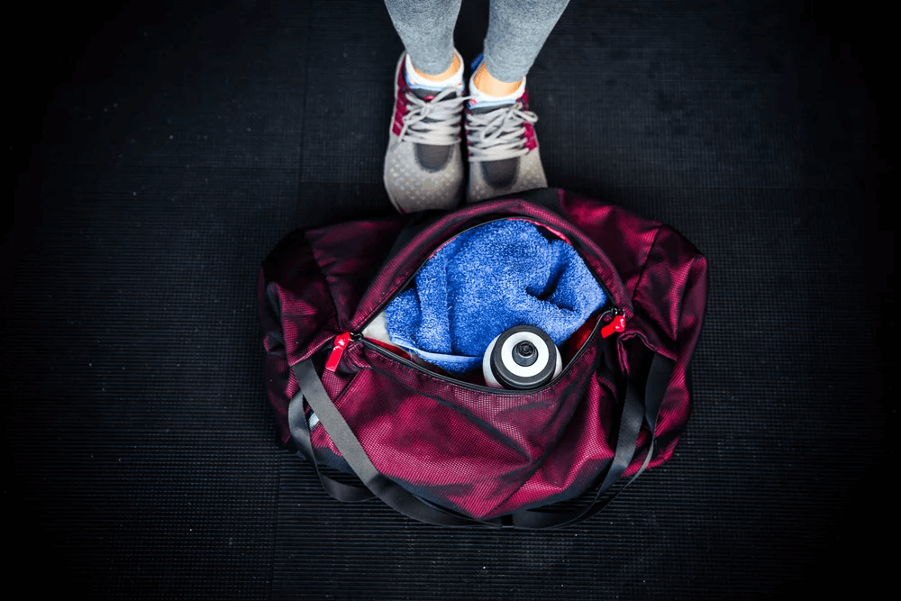 Closeup image of fitness bag with female legs (1)