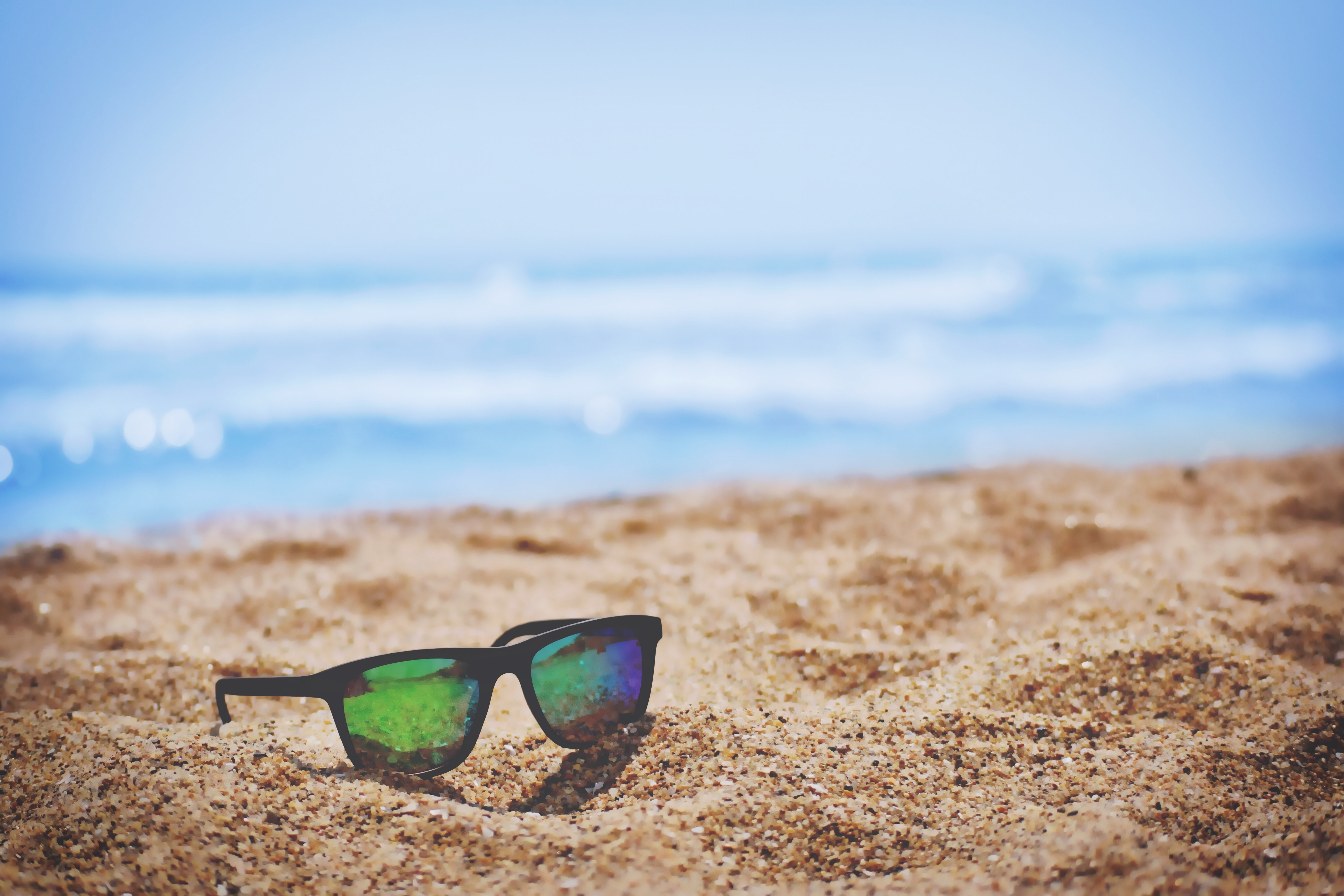 Sunglasses in the sand. Photo by Sai Kiran Anagani on Unsplash.com