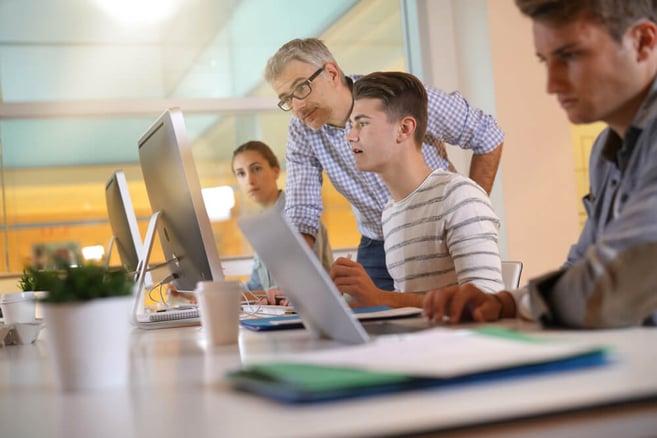 apprentice_student_teacher_desk_officeshutterstock_1034507155 (1)