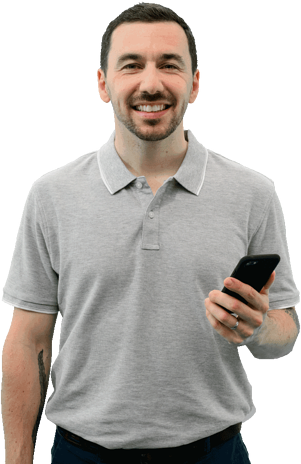 breathe_man_employee_looking_confident_at_the_camera_holding_mobile_phone