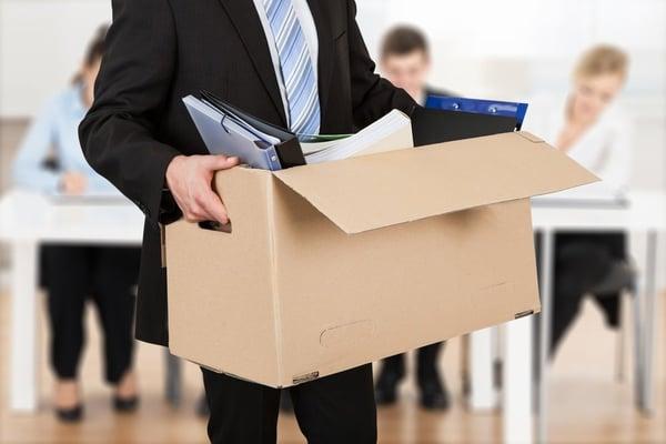Redundant employee carrying their box of belongings