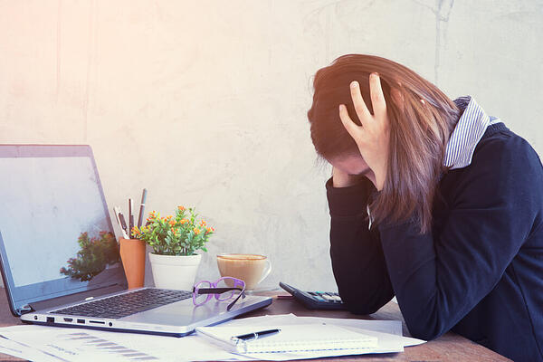 mental health in the workplace_Stress_employee_work_laptop
