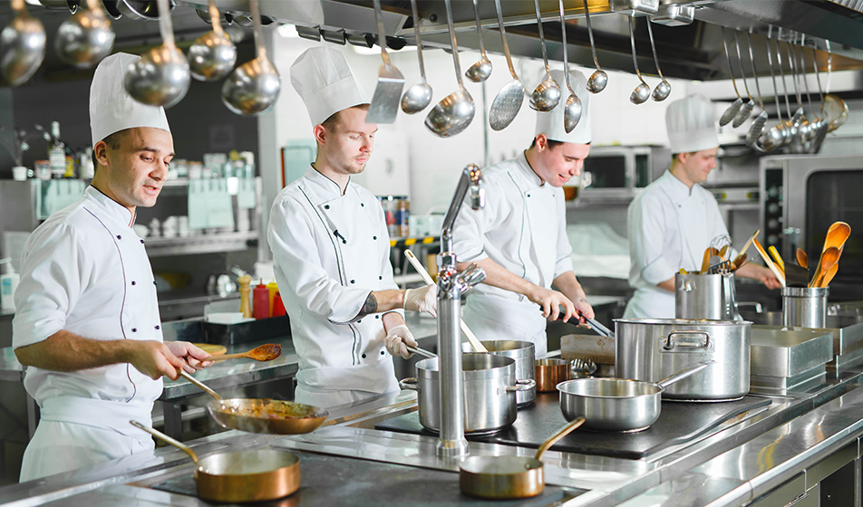 Chefs working in a busy kitchen