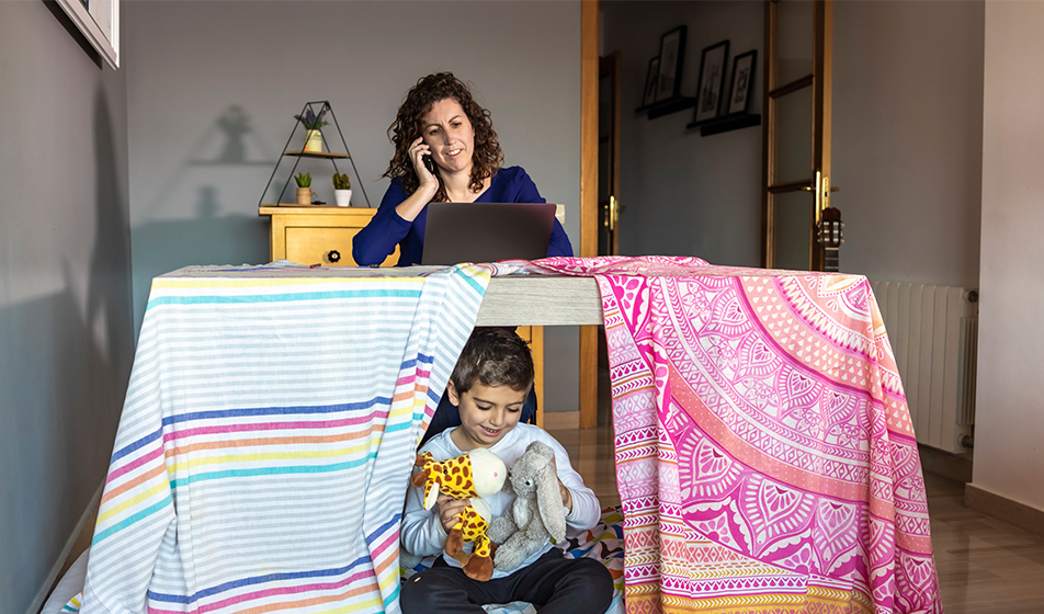 Woman working from home with her child