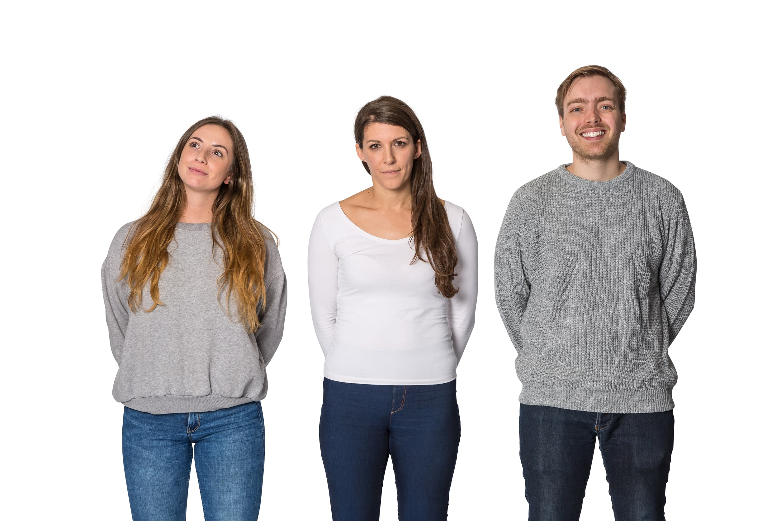 Happy, thoughtful and unhappy employees standing in a row