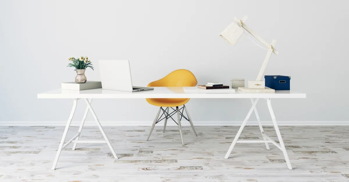 Modern white desk and orange chair set up for working from home